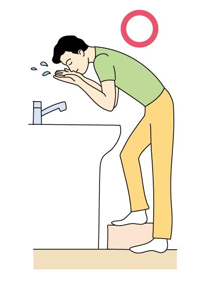 腰痛 中腰の姿勢で顔を洗う