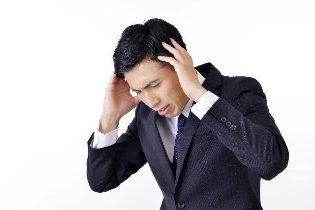 腰痛克服 悩む男性