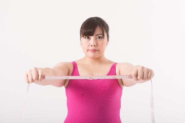 腰痛克服 ダイエットする女性